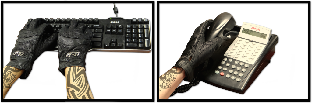 Tattoo handss on keyboard and phone with harley gloves